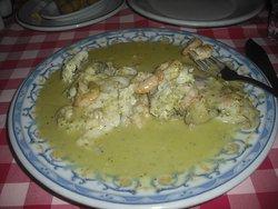 Merluza en salsa verde-a Casa Salavador speciality.