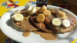 Delicious bananas foster pancakes!  Available as french toast too!