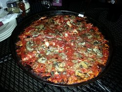 an extra large cheese, sausage & Mushroom pizza