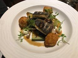 Grilled fillet of Seabass, toasted cucumber, Asian mushrooms, prawn sesame fishcakes, wasabi cre