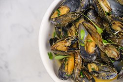 Mussels with white wine, shallots, parsley and garlic toast.