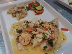 Pompano Key West! Sautéed Pompano Fish filet topped with Shrimp, Crab, Mushrooms, Leeks, Sweet Bell Pepper & a Lemon, White Wine, Butter sauce!