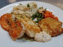One of our faves! Seafood Medley - White Fish, sauteed Shrimp and Crab Cakes served with Remoulade!
