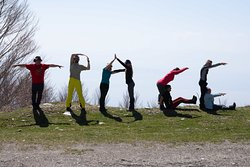 Hikers make the word TRACE with their bodies