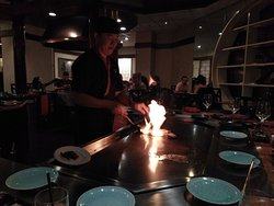 Chef flambéing our food in front of us.
