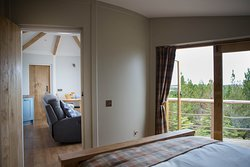 View from your bed and bedroom out over the forest. Step out on to the balcony in the morning for some fresh forest and sea air!