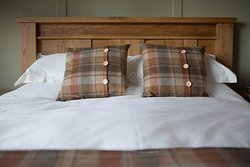King size chunky oak bed, feather duvet and pure cotton sheets