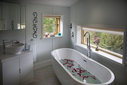 Freestanding double ended bath. Picture window to soak up the views! Water is by private borehole that goes down 52m, that's 25m below sea level. Just pure water in a large comfortable bath, surrounded by nature.