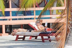Relax on the beach in front of your private cabana
