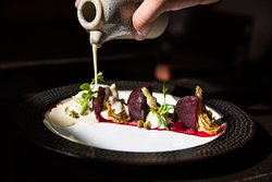 One of our dishes in the daily changing 4-Course menu! - Vegetarian dish with beetroot, local goat cheese & spouts, artichokes & bechamel