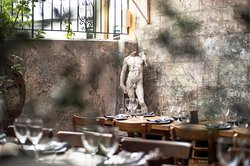 Dine in our Tuscan courtyard