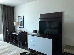 Refrigerator, coffee pot, TV and desk