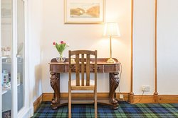 The welcoming vestibule features a tartan carpet that speaks to one of the owners' heritage at Blenheim Lodge. The other owner is Singaporean.