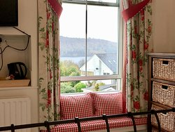 Window view of Lake Windermere and Claife Heights fell from this small window seat.