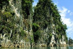 Majestic limestone cliffs border the lake