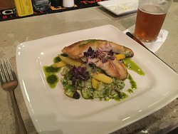 Sheepshead (fish) over rice & vegetables with basil pesto