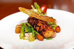 LOUISIANNA SALMON STEAK Louisiana style rosemary saute salmon. Served with boiled vegetables & potato...
