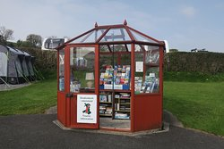 Information hut  with books, DVDs and jig sawa to borrow as well an onformation brochures