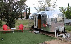 A 1955 Airstream and its patio at Shady Dell.