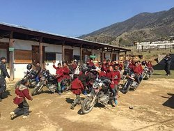 The young nomads of high land in Bhutan so curious with our motorcycle.