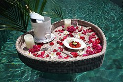 Is there anything more romantic than a floating heart-shaped tray for two?  We know how to create a memorable romantic journey just for the two of you, visit us here for more enchanting ideas to rekindle your love https://www.samabe.com/en/bali-weddings/enchanting-ideas.php …