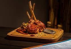 Turn up the notch for dinner this week with our Sancho's Lamb Pops; served with chipotle rubbed lamb chops, eggplant puree, chiles toreados and finished with adobo sauce. Did you forget to give us a call? It's not too late to change that and pencil us in!
