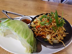 Lettuce wraps with wok veggies, noodles, and hoisin sauce