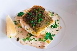 Blue Eye Cod: pan-roasted with a lemon herb crust on creamed leeks & mustard greens