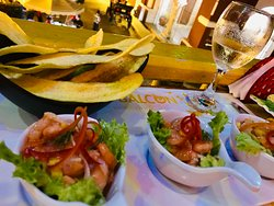 Sexviche, a tasty ceviche of fish and shrimp, each bowl with a dollop of fresh guacamole, served with crispy, lightly salted plantains and a view of the plaza below.