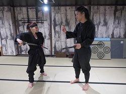 Sensei Gin explaining sword techniques