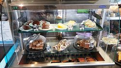 A fine selection of cakes, hot food is also available.