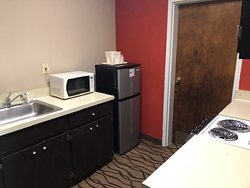Microwave and refrigerator (large for most motel rooms)