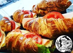 Butter Croissant with tomato, cheese, lettuce and turkey.