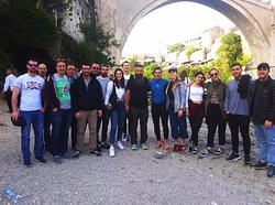 Our Sunday evening Free Tour with Sheva under the Old Bridge mugging for the camera with one of Mostar's famous traditional bridge divers just after a dive in to the icy Neretva! Hear all about the history, tradition, and legends of the Old Bridge with Sheva and see a diver in action - are you brave enough to train for a jump? Head to the divers club...!