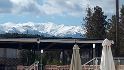 view of mountains with snow on them whist sunbathing at the pool