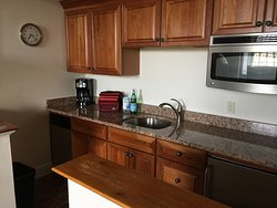 Nice little kitchen area with small fridge, dishwasher and coffee pot and toaster