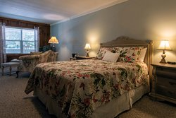 A1 - The Cattail Room Ground floor room with 1 queen bed, sitting area with love seat and chair. This room faces the koi pond and shares a covered porch with 1 other room. Pet friendly.