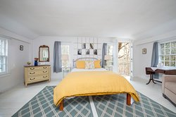 Master Bedroom of The Carriage House Suite.