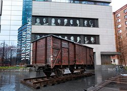 """A German freight car in front of the Museum, one of the artifacts from the exhibition """"Auschwitz. Not long ago. Not far away."""" on view at the Museum starting May 8, 2019."""