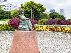 Statue of the Girl with Red Shoes