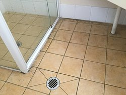 Bathroom floor under the wash basin and around the shower area
