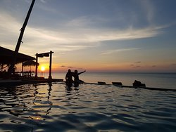 pool to sea view with sunset. we just loved it