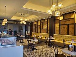Aroma cafe for all your coffee needs Menus include; espresso, lattes, macchiatos, teas, icecream sundaes...