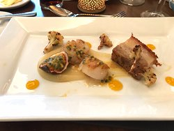 Seared scallops and pork belly starter.