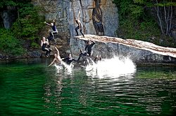 Divers jumping off Wedge Rock, Summersville Lake, WV.
