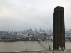 Smoke stack at Tate Modern, former power plant. Nice walking bridge below worth coming back for after tour, and to museum galleries. Close to where tour ends so best to do it then while it's there-- Borough Market.