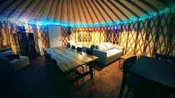 The interior of our cozy Nights Under Lights yurt.