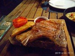 Slab of pork on a salt brick