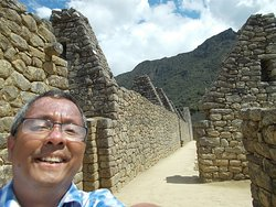 """Among the ruins with some """"triangular tops"""" seen behind me (on the side across the grounds from Templo del Sol)"""
