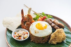 Indonesia food always ready to tantalize your taste buds. Ibu Kitchen delivers perfect recipe with strong in condiment to make a great taste. For more information, click here: https://www.grandmirage.com/en/restaurant/ibu-kitchen-restaurant.php